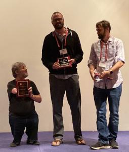 Shaun K. Kane (left), Jacob O. Wobbrock (middle) and Jeffrey P. Bigham (right) accepting the 2019 SIGACCESS ASSETS Impact Award (Image Source: https://twitter.com/jeffbigham/status/1192075687403958272/photo/1)